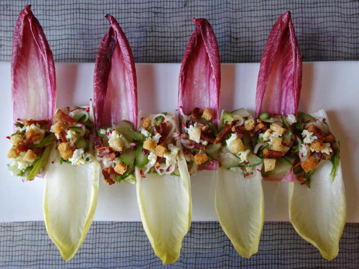 Asparagus, Cucumber & Radish Salad in Endive with Mustard Tarragon Vinagrette