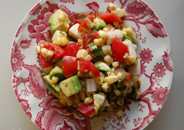 Heart of palm salad with summer tomatoes, avocado and fresh corn